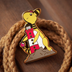 Cute Ampharos enamel pin and its tiny lighthouse.