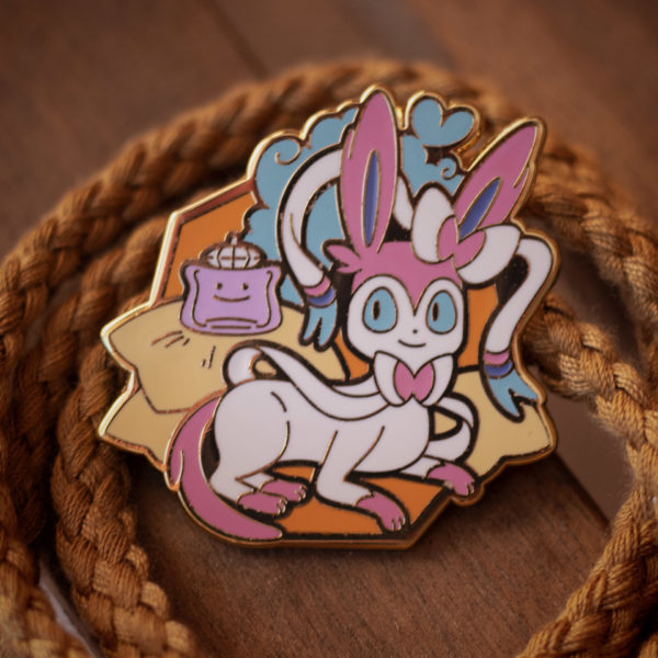 Sylveon enamel pin, with its Ditto perfume bottle friend!
