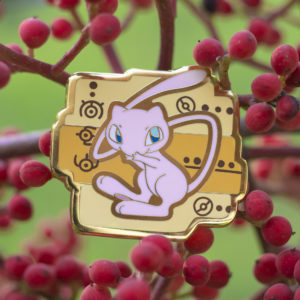 Ancient Mew gold plating hard enamel pin surrounded by berries